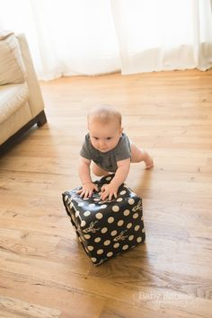 """When Lowell, my 10 month old, started pulling up a couple months ago, I realized we didn't have many toys that he could safely push around on our hardwoods with"""