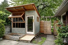 Concrete and wood potting shed.