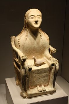Terracotta statue of a throned divinity, probably Demeter (Goddess of harvests and earth fertility). Late 6th, early 5th century BCE, from Sicily. (Archaeological Museum, Milan)