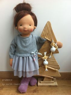 Knit fabric for the top, and see through fabric for the skirt. Beautiful dress by North Coast Dolls