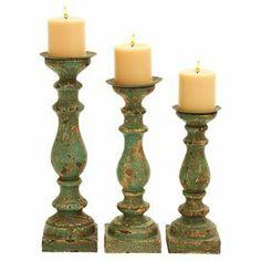 """Set of three spooled wood candleholders with distressed green finishes.  Product: Small, medium, and large candleholderConstruction Material: WoodColor: Distressed greenAccommodates: (1) Candle each - not includedDimensions: Small: 12"""" H Medium: 14"""" H Large: 15"""" H"""
