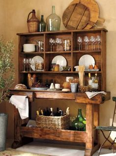 This is a work table with a hutch...great idea! I think I'll try to have this made.