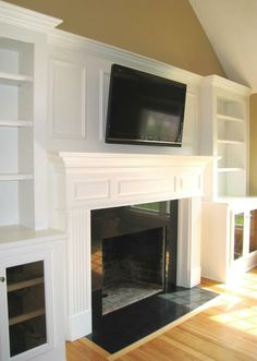 living room and fireplace with bookshelves - maybe do board & batten behind fireplace to blend it all together?