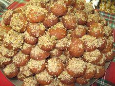 Τα πιο νόστιμα και αρωματικά μελομακάρονα που έχετε δοκιμάσει! Υλικά 2 φλ. ηλιέλαιο ή καλαμποκέλαιο ή ελαιόλαδο 1/2 φλ. χυμό πορτοκαλιού 1/2 φλ. κονιάκ 1 κ.γ. φρεσκοτριμμένο μοσχοκάρυδο 1 κ.γ. τριμμένο μπαχάρι (all spice ) 1