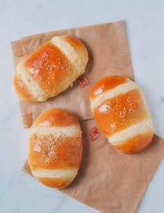 Coconut Buns (Chinese Cocktail Buns) | The Woks of Life Asian Desserts, Asian Recipes, Chinese Desserts, Coconut Buns, Bun Recipe, Almond Cookies, Dim Sum, Baked Goods, Bagels