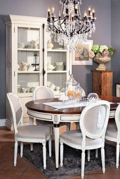 Pretty White and grey dining room with chandelier