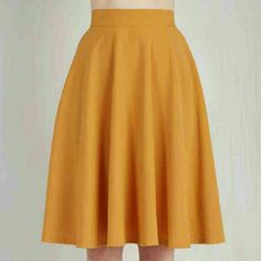 Circle skirt This high waisted, vintage inspired circle skirt is a lovely shade of mustard yellow. Has a side zipper and button. ModCloth Skirts Midi