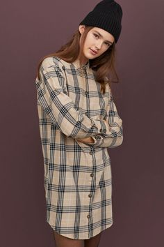 Straight-cut shirt dress in woven fabric. Collar yoke and buttons at front. Dropped shoulders long sleeves with buttons at cuffs and a rounded hem. Cut Shirts, Straight Cut, Shirt Dress, Blouse, Fashion Company, Neue Trends, World Of Fashion, Sleeve Styles, Shirt Style