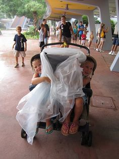 Disney world trip planning - best idea yet - bring a shower curtain to put over the stroller WHEN (not if) it rains.