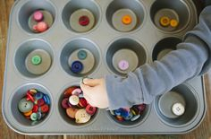 via bleubird blog: montessori buttons game -- sort buttons by color in a muffin tin