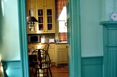 turquoise dining room and butter yellow kitchen