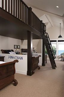 How cute- Half walls between the beds create separate spaces for each child to call their own while the overhead loft is a common play area.