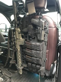 """""""I use an RMP inside the cab with the top secured around the headrest and the base around the bottom of the seat's connection to the powered tracks. I have w/ a 6 mag molle pouch, SIG 229 w/ 4 single mag pouches. Tactical Truck, Tactical Equipment, Tactical Survival, Tactical Gear, Tactical Wall, Military Weapons, Weapons Guns, Guns And Ammo, Weapon Storage"""