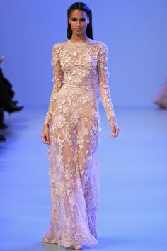pretty..reminds me of queen bey's red carpet dress..