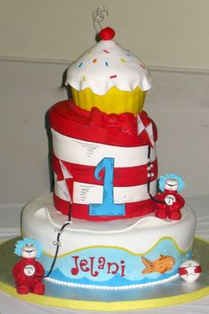 """Dr. Suess first birthday cake.  We can help achieve this look at Dallas Foam with cake dummies, cupcake stands and cakeboards. Just use """"2015pinterest"""" as the item code and receive 10% off your first order @ www.dallas-foam.com. Like us on Facebook for more discount offers!"""