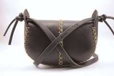 This leather bag is in stock and will ship in 3-5 business days. You will receive a bag like the one pictured pictured on the white background