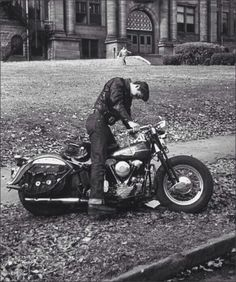 1950s Greaser leaving high school and about to start up his motorbike.