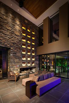 Beautiful wall of candles.  Gerson remote control candles maybe?  contemporary family room Contemporary Family Room