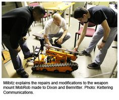 Milbitz explaining the  robot repairs.