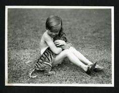 Unidentified child with tiger cub photographed during the the National Geographic Society-Smithsonian Institution Expedition to the Dutch East Indies, 1937 Stock Photo Pet Tiger, Tiger Cub, National Geographic Society, Dutch East Indies, Vintage Photography, Cubs, Baby Animals, Stock Photos, Children