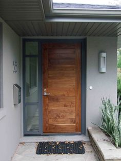 Stunning Natural Brown Single Modern Front Door With Nickel Knob Handle Door Also Grey Clear Glass Single Entrance Window Frames As Well As Grey Wooden Ceiling Exterior Designs