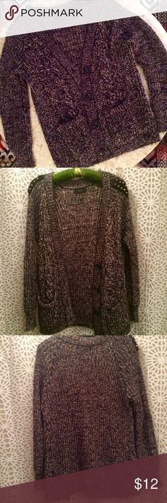 Jessica Simpson Sweater Jessica Simpson crocheted sweater with studded shoulders.  Made of polyester & acrylic.  one of the studs is missing on one shoulder.  Size M, but if you're smaller than a M it would be perfectly baggy and comfortable!  Main color is black with pastel pinks and greens threaded through. Jessica Simpson Sweaters Cardigans