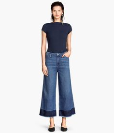 Medium washed jeans, with color blocking and  high waist and raw edges at the hems.
