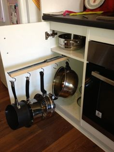 Easy DIY Saucepan Cupboard Storage. $22 Sliding Bracket From Bunnings A $3  Piece Of Pine And Some Hooks. Screw A Piece Of Pine To The Bracket Screw In  Hooks ...