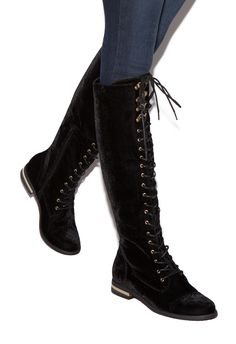 8f9adbbf972 Be a tough girl in knee-high combat boots. A lace-up closure