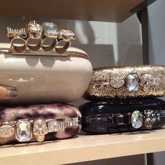 Alexander McQueen knuckle brass clutches.