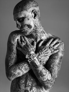 i really like this guy i think his tats are awesome i can't even imagine getting tattooed around my eyes and in my ears