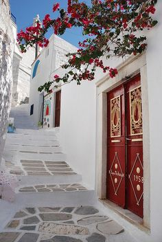 Naxos, stone streets, stone houses with hand worked stucco, hand thrown tiles