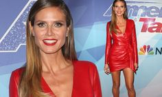 Heidi Klum, 44, ensured all focus on herself as she showcased her svelte frame in a skin-tight plunging red dress for the America's Got Talent finals on Tuesday.