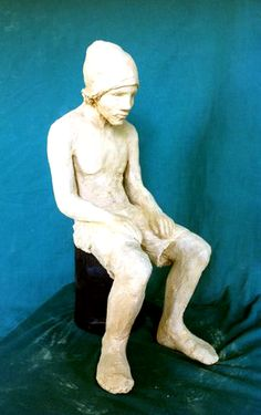 Kobus young man sitting clay sculpture