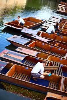 Punts, an open flatbottom boat with squared ends, used in shallow waters & usually propelled by a long pole, Cambridge, England..