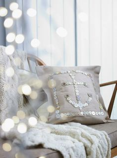 How about an easy peasy DIY nautical pillow? All you need is a throw pillow, buttons, sequins, and a needle and thread!