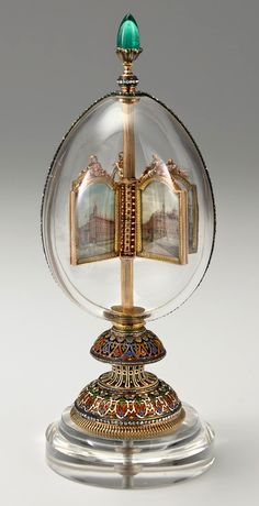 The Egg With Rotating Miniatures was created in 1896 as a present from Nikolay II for Alexandra Feodorovna. The egg was made from rock-crystal, 12 miniatures inside it presented 12 showplaces memorable for Alexandra. Today the egg is owned by The Virginia Museum of Fine Arts, The USA.