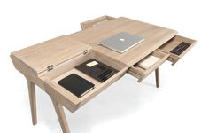 Meet the compact desk that comes equipped with 3 doors, 2 lidded compartments, and even a secret stash