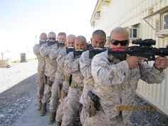 U.S. Marines with combat ready gun mustaches.