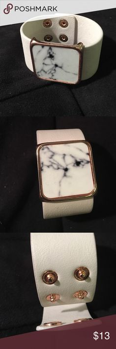 Marble Print Cuff Bracelet White leather like cuff bracelet with a marble printed accent. Two settings for tightness. Worn once H&M Jewelry Bracelets