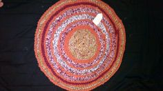 beautiful orange and red crochet rug made by my daugher..Brittani