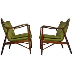 Pair of Finn Juhl Chairs | From a unique collection of antique and modern lounge chairs at https://www.1stdibs.com/furniture/seating/lounge-chairs/
