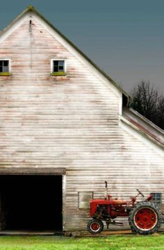 white barn and chore tractor