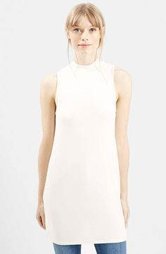 Free shipping and returns on Topshop High Neck Jersey Tunic at Nordstrom.com. Whether you wear it as a longline top or a leg-flaunting dress, this sleeveless tunic is cut to gradually flare into a flippy silhouette shaped by gentle pleats.