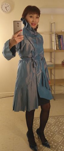 Delicate Pearly Blue Shiny Duster with Asymmetric Pleats can be worn for any occasion as a stylish statement.