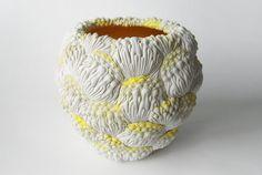 hitomi hosono carves porcelain sculptures to resemble tropical botanicals