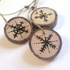 Individually wood-burned snowflake ornaments, set of three. Each ornament is crafted from a storm-felled tree branch and hung on twine. Now available on Etsy for $9.95! #hostessgift #ornament #uniquegift