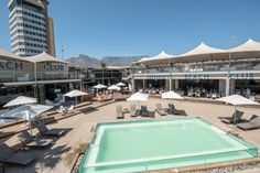 Shimmy Beach Club, a premier venue in the V&A Waterfront. Private beach, enjoy your cocktails here, Book a lounger for the day V&a Waterfront, The V&a, Beach Club, Cape Town, Sun Lounger, Night Life, Gazebo, Cocktails, Deck