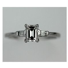 Just stunning.. love the vintage look. paired with a simple white gold wedding band..