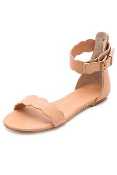 Isa Tapia Juanita Scalloped Flat Sandals, $350, available at Shopbop.